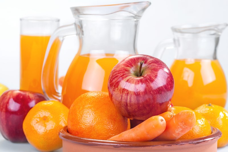 apple, orange and carrots with juice